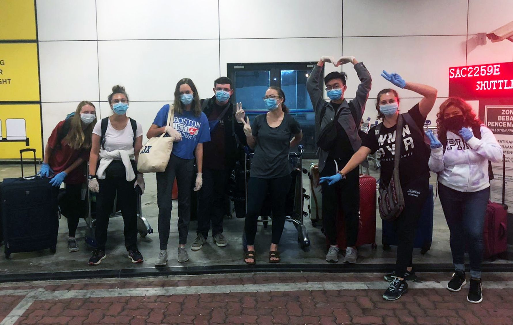 Dustin (third from the right) and fellow Fulbright scholars from across Malaysia at the airport prior to their emergency evacuation back to the U.S.