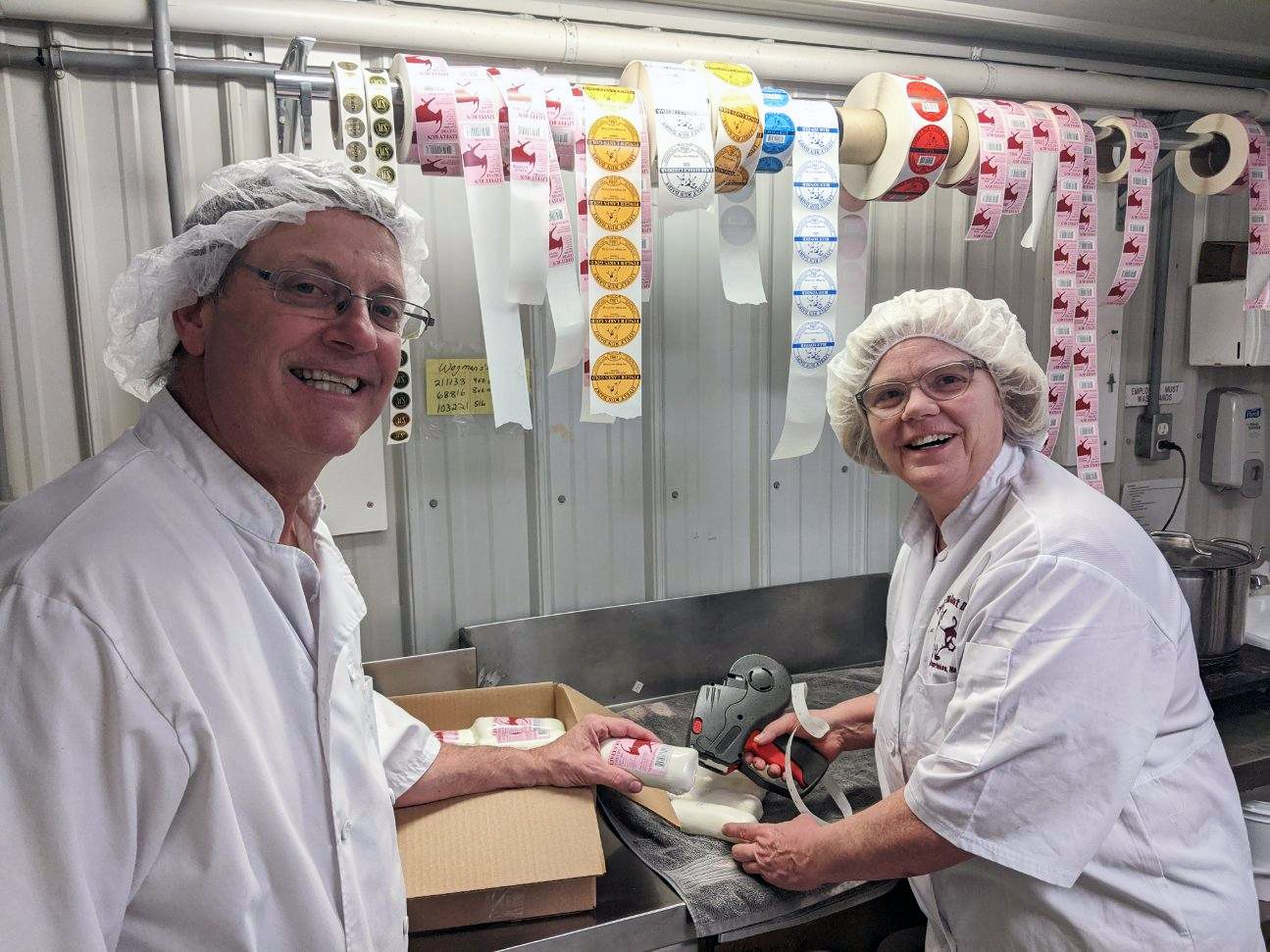 Steve and Susanne Messmer packaging cheese donations.