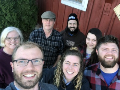 (front row L-R) Dave Messmer '17, Katie Shaw, Pete Messmer, (back row, L-R) Susanne Messmer, Steve Messmer, Robert Theetge, and Valerie DeLong at Lively Run Goat Dairy.