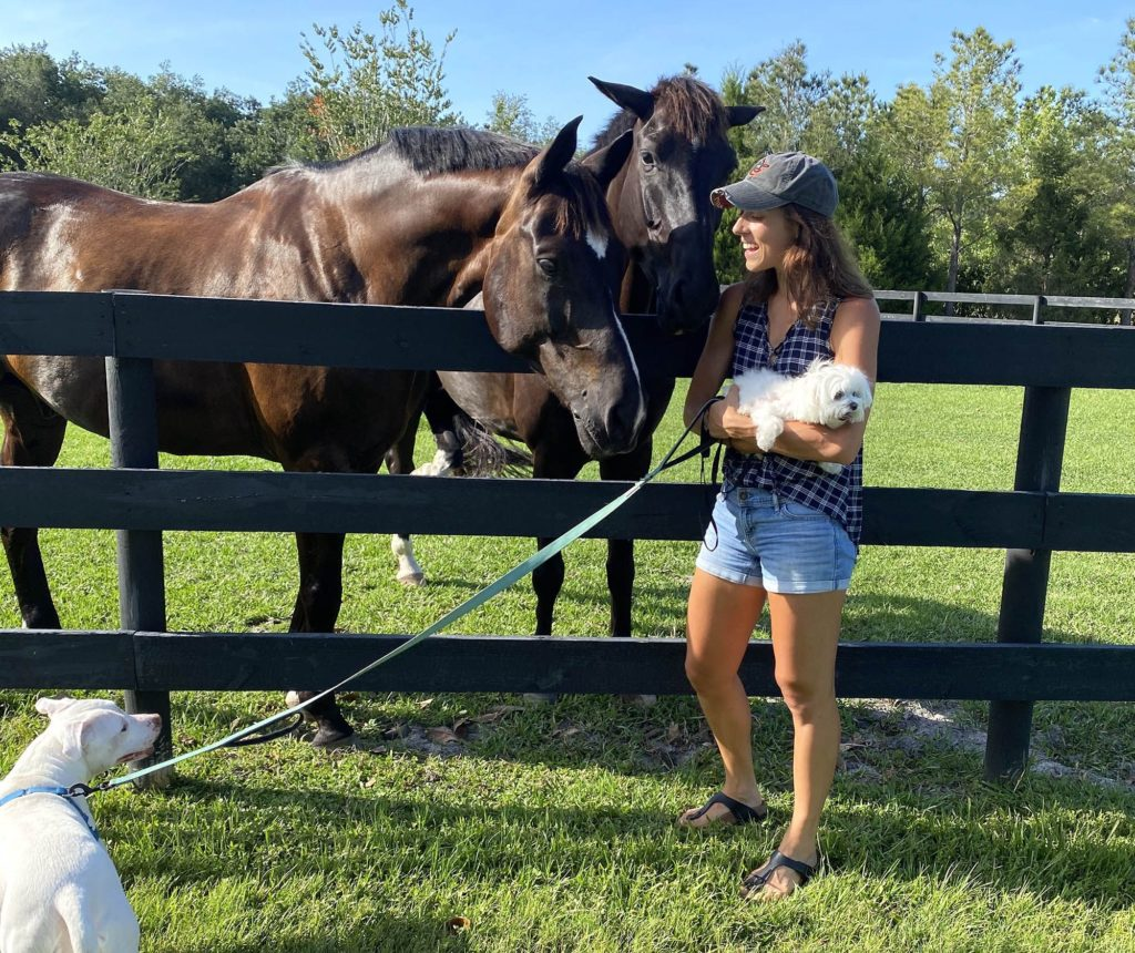Alexandra enjoying dog walks and spending quality time with her family's horses, Paulie (left) and Q (right).