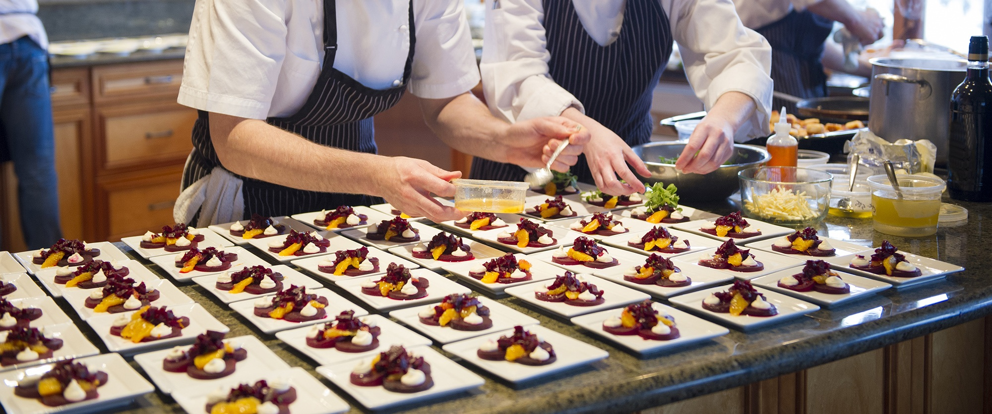 Chefs plating up a beet salad