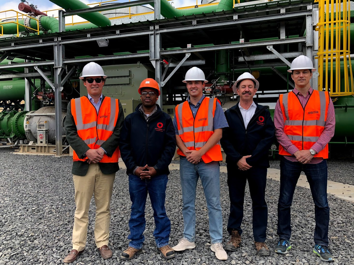 Jones (far right) and colleagues at Ormat's geothermal complex in Kenya. Jones and his team helped arrange $310 million in financing for this project.