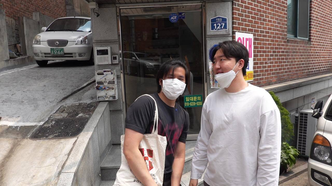 "Eric (left) on his first day out of quarantine in Seoul. ""My hair is very messy because I couldn't get it trimmed in the States,"" he says."