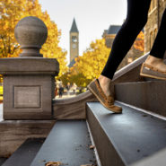 Students climb the steps of McGraw Hall just before the start of classes.