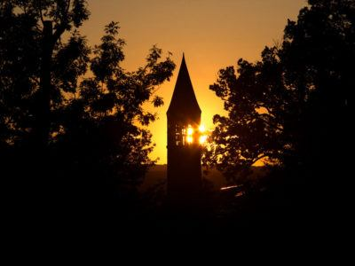 Sunrise over McGraw Tower in fall.