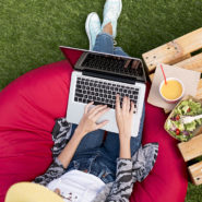 Woman on laptop outside - photo created by freepik