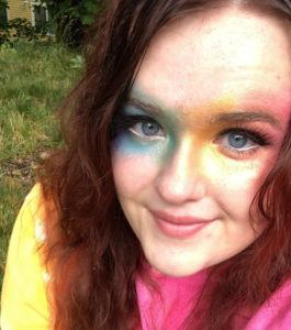 """Jocelyn celebrating Pride Month from home. """"Cover your face, not your pride,"""" she says."""
