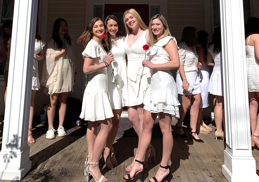 Triff H'Doubler '23, Amaya Bremauntz '23, Grayson Rosenberg '23, and Holly Staid '23 on the steps of their sorority house.