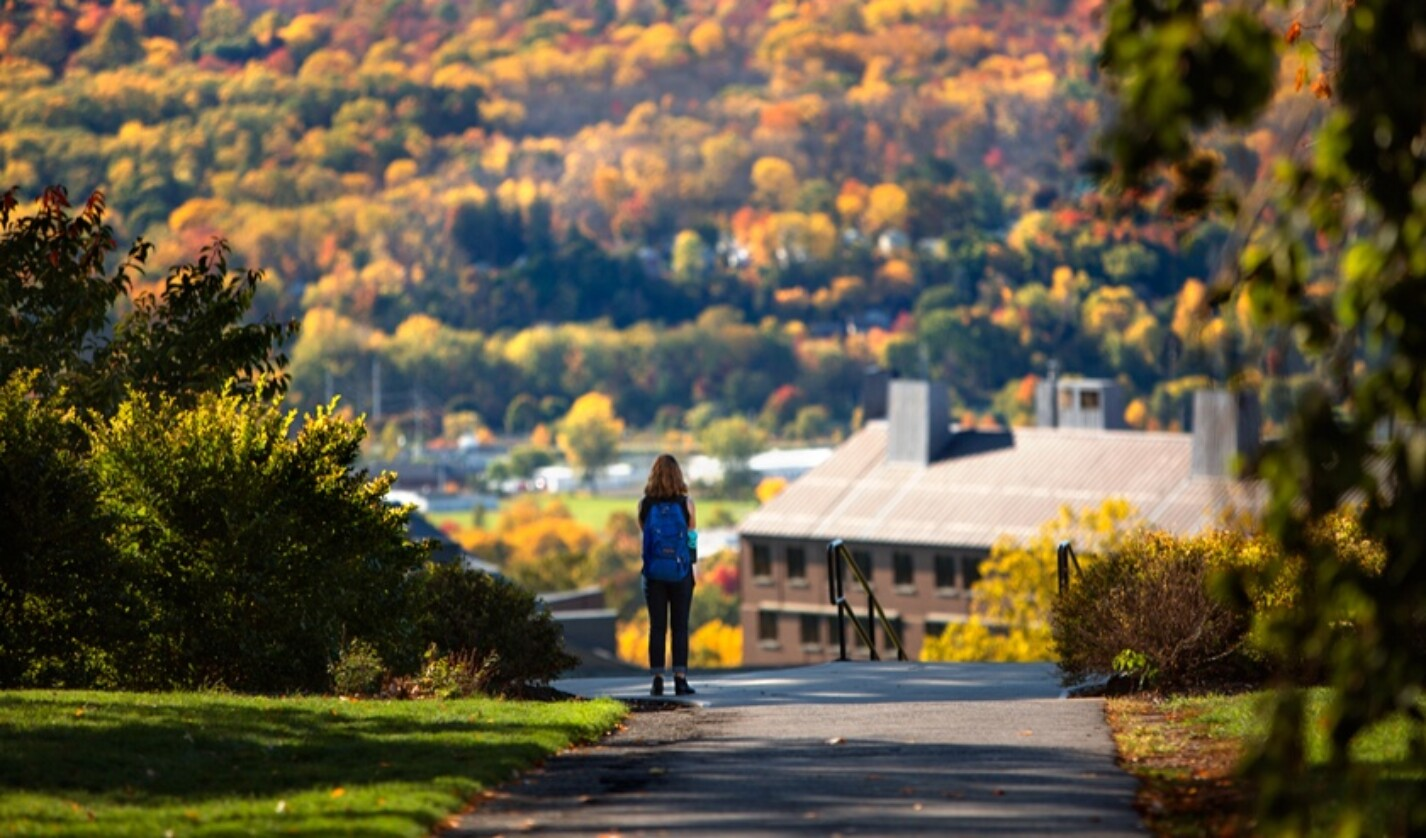 student on campus in fall