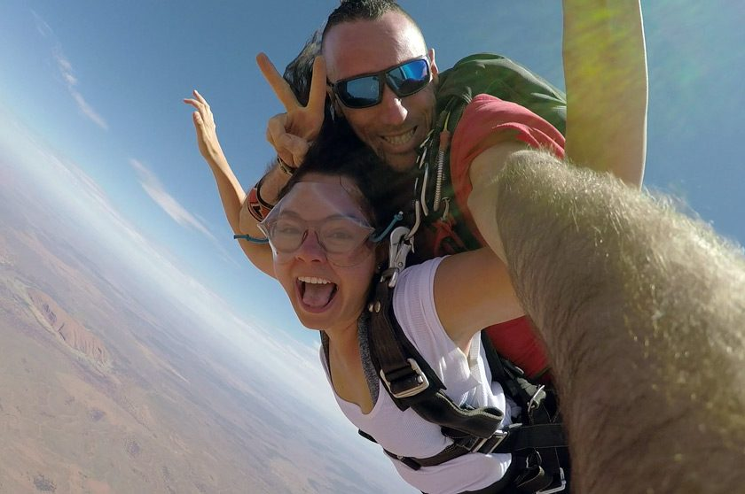 "Camila Salazar skydiving over Uluru, the sacred giant rock in Australia's outback. ""If you look closely, you can see it in the background!"" Camila says."