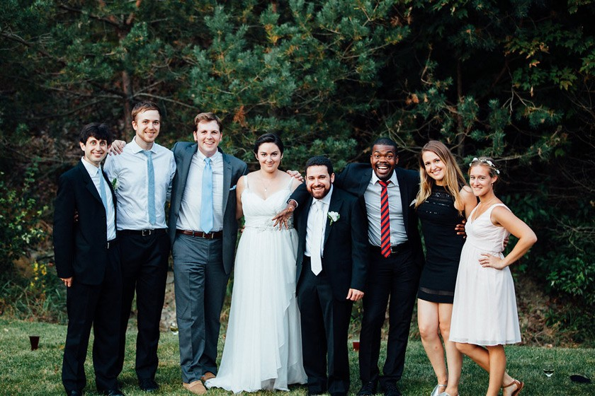 (left to right) Zach Glass '09, Alec Story '12, Ian Harkins '11, Jess Kelley-Madera '12, Christian Kelley-Madera '10, Paul Notice (the only non-Cornellian in the photo), Julie Reed '12, and Anya Gibian '12 at the Kelley-Madera wedding in 2015.
