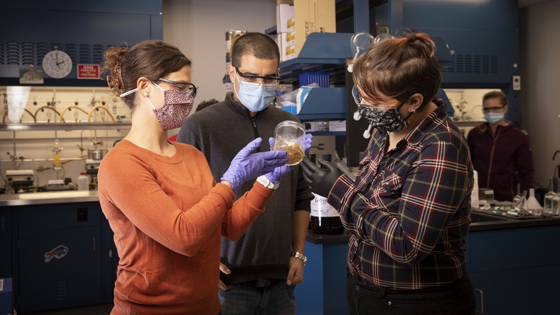 Co-founders of Ecolectro and an analytical chemist examine a prototype polymer batch prior to shipping to an industry partner.