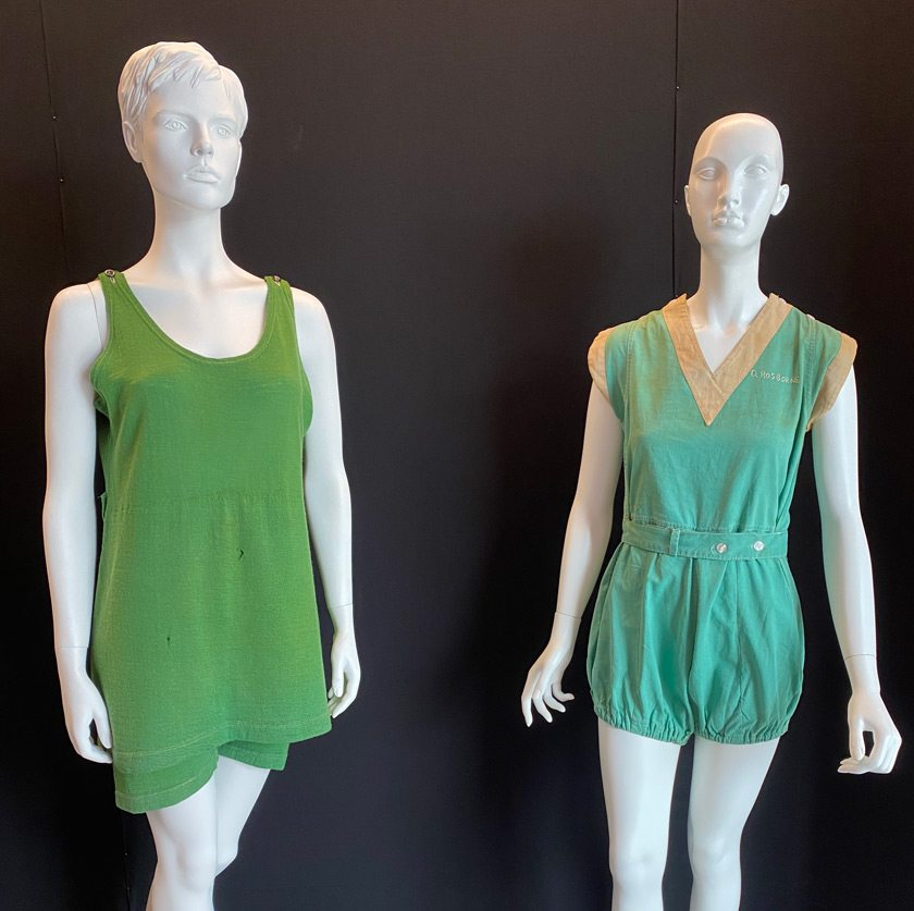 A 1920s swimsuit (left) and a 1930s gymsuit (right) featured in Green Armor, a fashion exhibit designed and produced by students in Denise Nicole Green's Curating Fashion Exhibitions class.