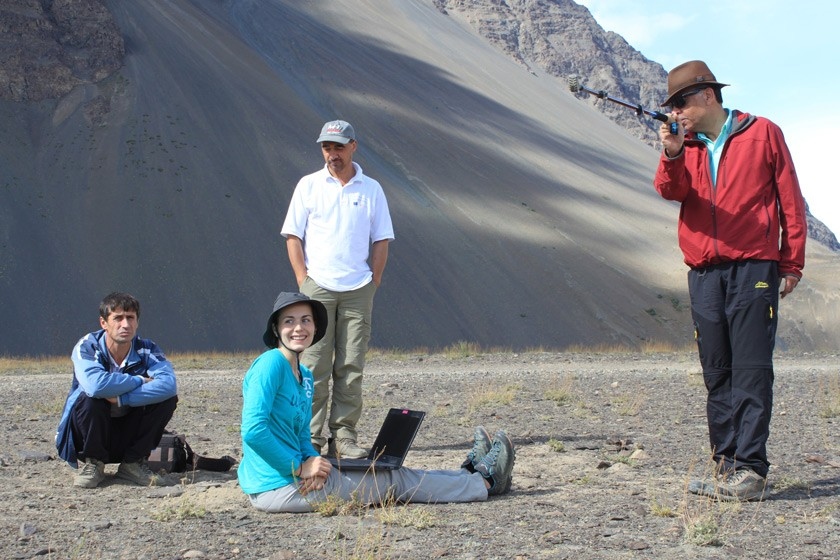 Karim-Aly Kassam and the Ecological Calendars Research Team enjoy a pleasant moment while Isabell Haag, PhD candidate at the University of Bayreuth, downloads climate data from sensors in the Pamir Mountains.