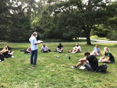 Professor Louis A. Derry working with his biogeochemistry students on a soil carbon experiment at Cornell Botanic Gardens.