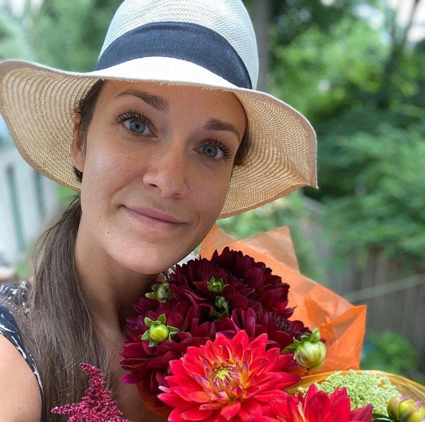 Marta H. Wisniewskaenjoying summer weather and summer crops,freshlybought at the Ithaca Farmers' Market.