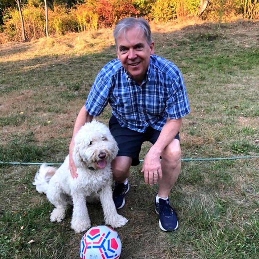 "Steve Hilgartner enjoys playing ""dog soccer"" with Lulli, the course mascot."