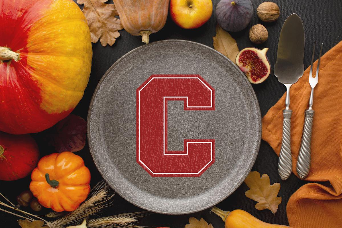 pumpkin table setting with Cornell C on a plate