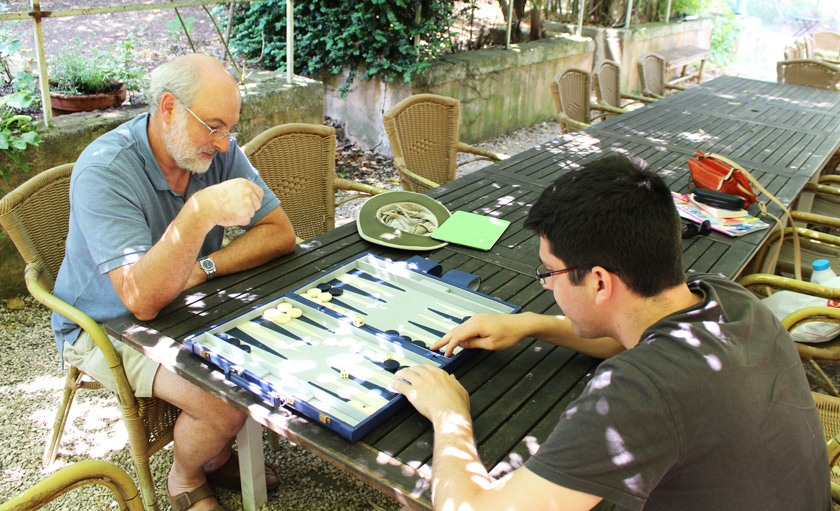 Ken Birman playing Backgammon with his nephew, the Belgian national Go champion, Lucas Neirynck.