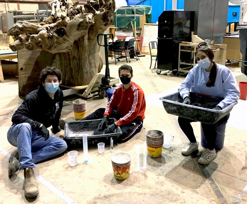 Members of Pod 1 making the most of their new space in the High Voltage Lab.
