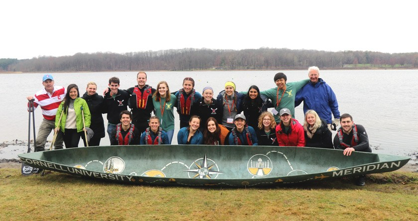 The Cornell Concrete Canoe team at competition in 2019 with their boat, Meridian.