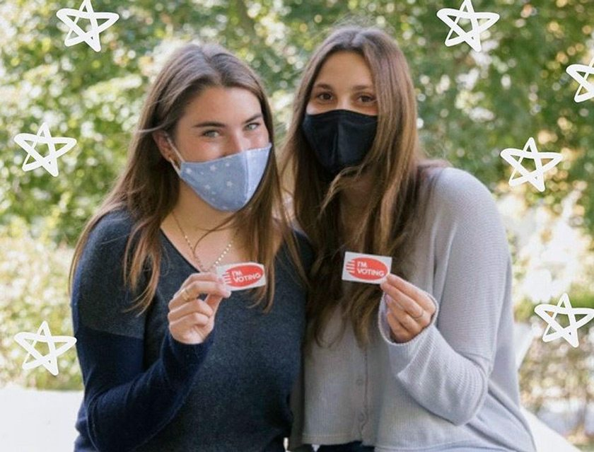 Members of Kappa Alpha Theta and Sigma Delta Tau committing to having a full voter turnout from their chapters. Credit: Hannah Rosenberg and the Cornell Daily Sun