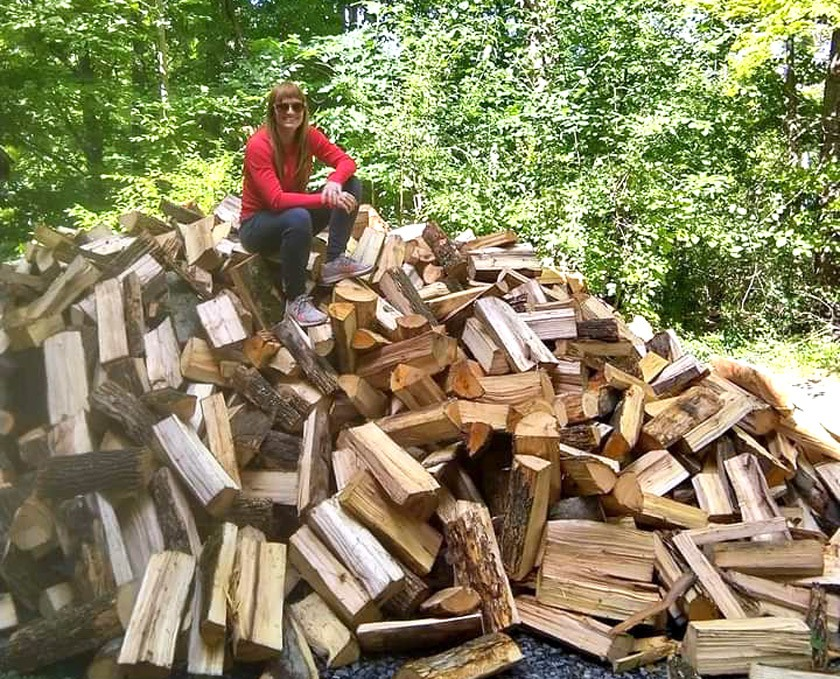 One of the ways Keri Johnson stays active in the fall and winter is by chopping fire wood!