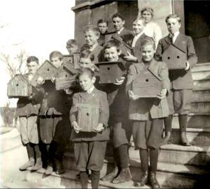 Students at the Cornell Nature Study School holding their birdhouses. The school was founded in 1897 by Anna Botsford Comstock and Liberty Hyde Bailey and offered lectures, lab work, and field work in the areas of insect, plant, and farm life.