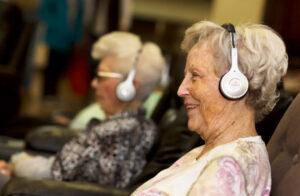Eversound customers usingtheir product—wireless headphones designed to improve quality of life for older adults.