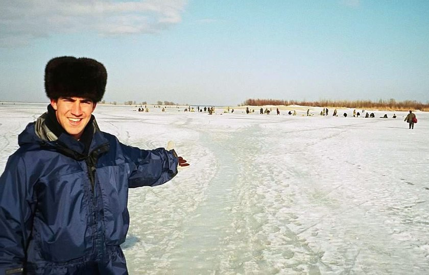 After graduation, Sam Sezak '98 was a Peace Corps volunteer in Ukraine, where he worked with small businesses. Here, he is watching locals ice fishing on the Dnipro River.