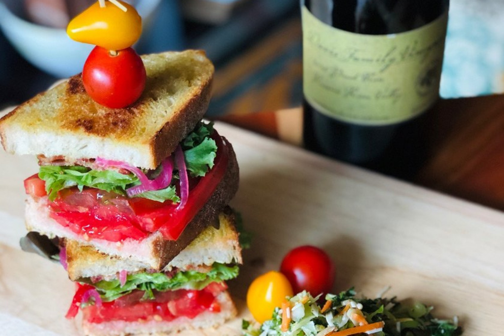One of Blake's culinary creations: Beef Master and Cherokee Purple heirloom tomatoes, toasted sourdough, Nueske Wisconsin smoked bacon, arugula, roasted garlic aioli, pickled shallots