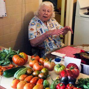 Marie Novak, garden consultant, looks over the day's harvest.