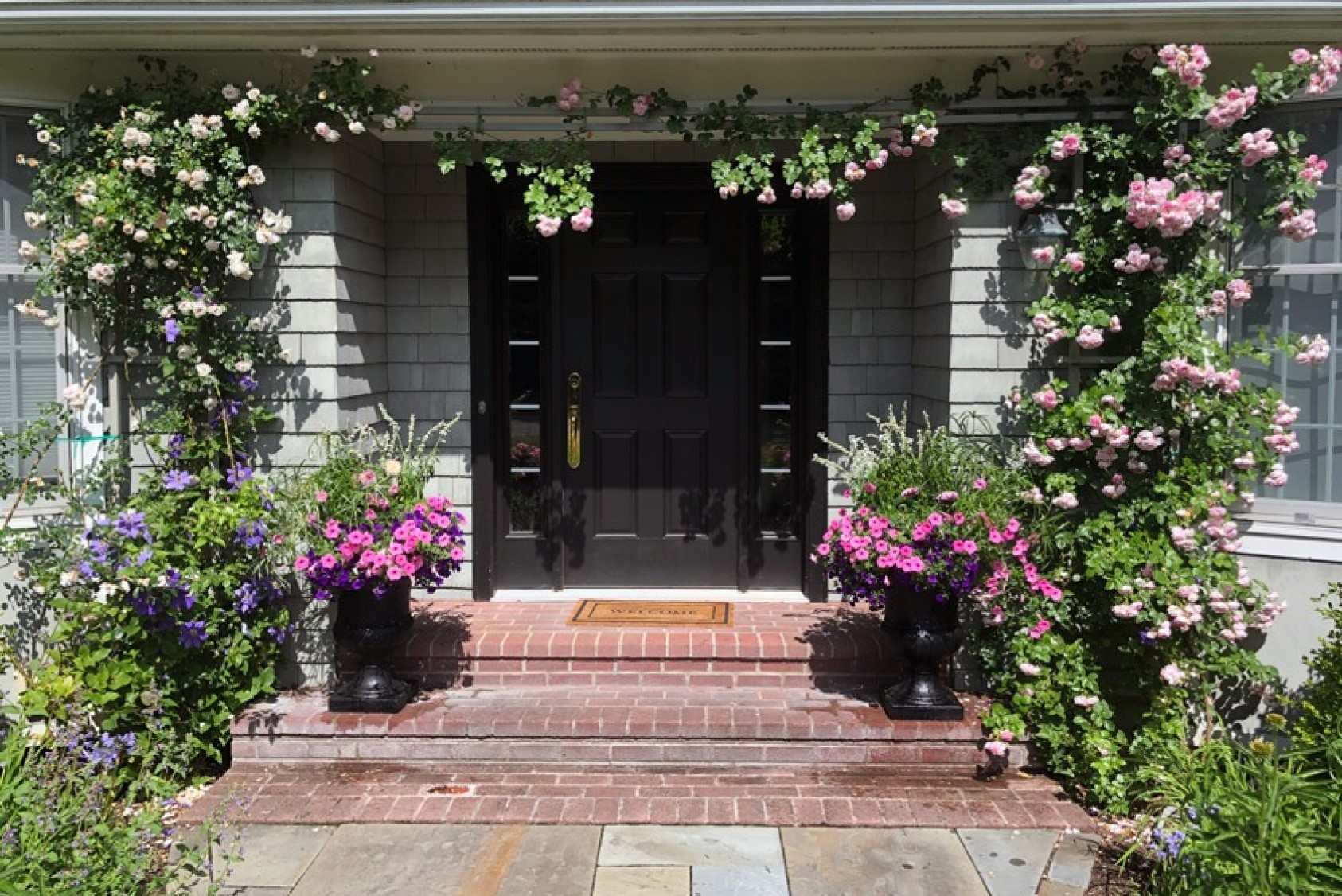 """Fred began gardening in earnest when he and his wife bought a house with about an acre of established, """"but rather untended"""" gardens in 2016. Here are the roses framing his front door in June 2020."""