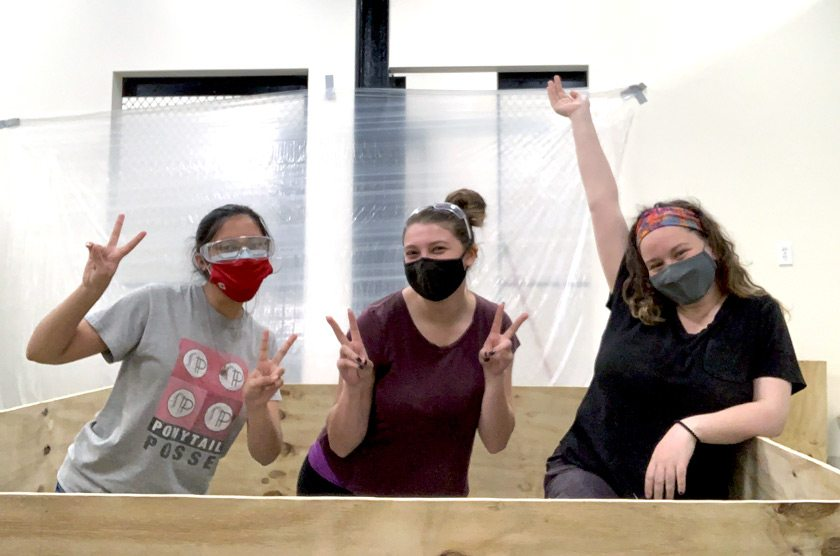INERTIA Build Team members (L to R) Sabriyah Taher, Sophia Peris, and Olivia Goosay '23 are building the wall of printers in the South Hill Business Campus Lab of Ithaca College.
