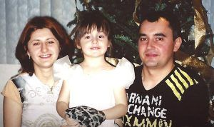 Karina as a toddler, with her mother, Alona Rudeychuk. and father, Oleksiy Popovych