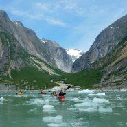 kayaks through an ice flow