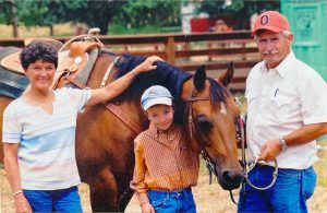Cole with his horse, Tuck, and his grandparents, Jim and Meryle Johnston, in 2007