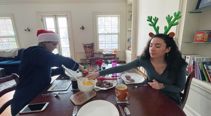 Maya and her roommate Claire Noack '20 on Christmas morning 2020 enjoying a brunch of eggs, sausage, and French toast casserole made by Claire. Credit: Jay Bender '20