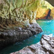Coastal cave with sparkling blue water