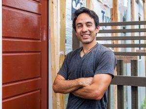 Alex Villagomez '03 at the door of the house he is building, Casa Linda