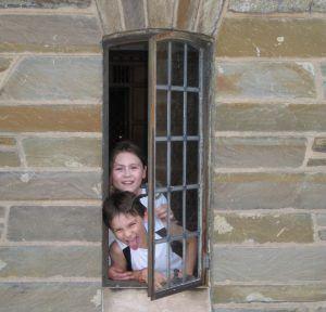 enata Geer's '82 children, Maya and Lukas, pose in a window at Willard Straight Hall in 2010