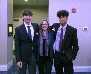 Lukas, Renata, and Lukas's friend and teammate, Bryce, at a baseball season kickoff dinner in December 2019