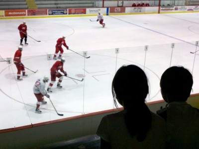 Renata Geer '82 photographed her children watching a Cornell ice hockey team practice in Lynah Rink.