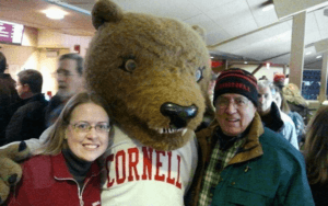 Dr. A'ndrea L. Van Schoick '96 and her dad with Touchdown the bear