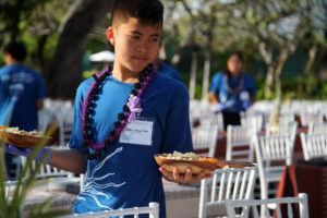 High school student on Hawai'i Island participating in the annual LEI overnight stay at the Mauna Kea Beach Resort in 2019. Students participate by serving and welcoming guests at the resort lu'au.
