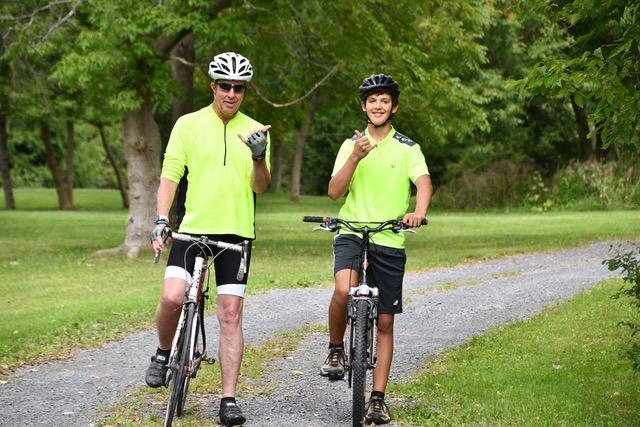 Bruce Monger biking with his stepson Dylan Rooney-Monger