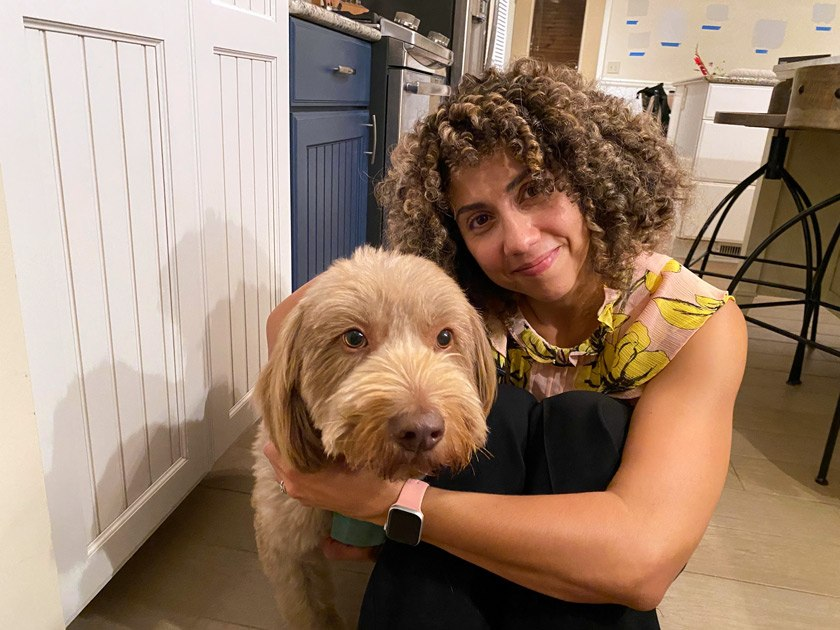 """Michelle Moyal adopted Chester through her own PCS service. """"This fuzzy, mild-mannered dogwas originally rescued as a stray from North Carolina,"""" she says. """"One of our student surgeons neutered him and removed some bird shot from his back leg. He has since become best friends with myotherdog, Carl!"""""""