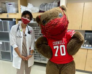 """Michelle Moyal after """"examining"""" Touchdown, the Big Red Bear"""