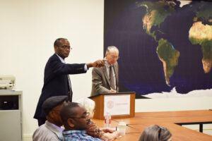 Muna Ndulo moderating a pre-pandemic seminar at Cornell Law School