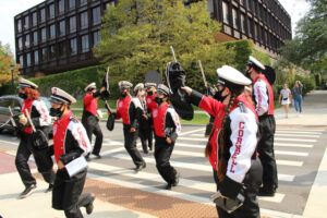 The BRMB parading outside of Uris Hall during Homecoming weekend